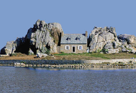 between: house on island between rocks ploumenach cote de granit rose cotes darmor brittany france europe