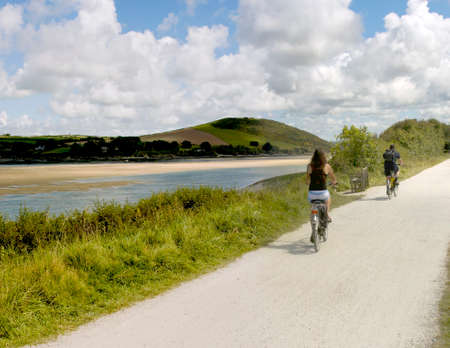 cycleway: the camel trail cycleway and footpath along disused railway line the estuary of the river camel padstow and rock cornish coast cornwall england uk