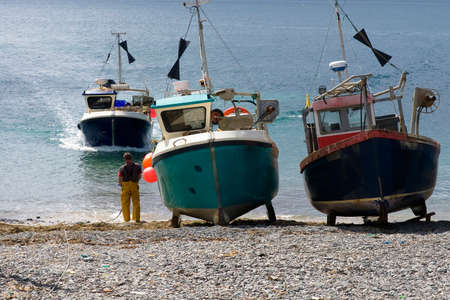 cadgwith harbour and bay fishing village and port cornwall england uk photo
