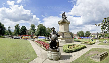 william: england midlands warwickshire STRATFORD UPON AVON stratford on avon canal bancroft basin statues falstaff in foreground william shakespeare behind. NB, This panorama is not interpolated or a crop. It is created from multi images.