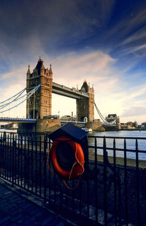 tower bridge river thames london viewed from the cannons outside the tower of london photo