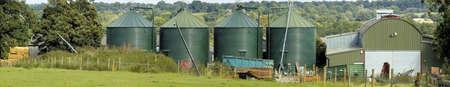 eyesore: a row of green tanks on farm