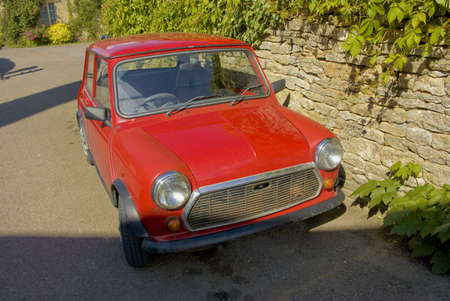 old red mini minor rusting and parked photo