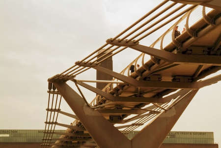 returning: millenium bridge river thames london england uk Stock Photo