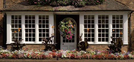 stratford: cottage decorated with flowers stratford upon avon warwickshire the midlands england uk