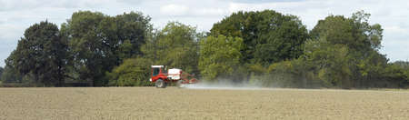 uncultivated: tractor spraying uncultivated field