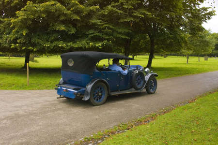 lanhydrock: vintage car taking tourists for a ride