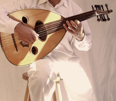 string instrument: arab musician playing traditional stringed instrument the oud
