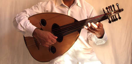 stringed instrument: arab musician playing traditional stringed instrument the oud       Stock Photo