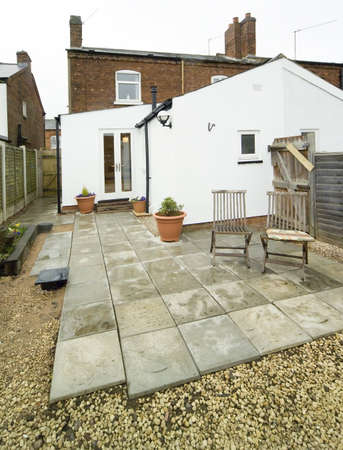 back garden of small terraced house with patio Stock Photo