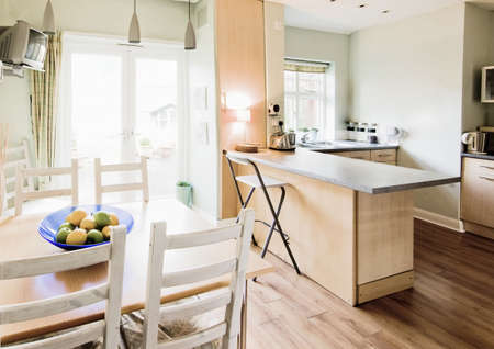 desk tidy: kitchen with appliances and table tops Stock Photo