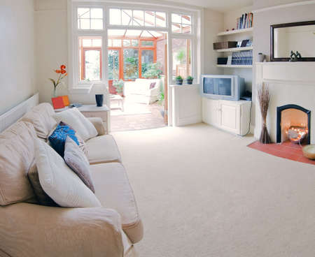 rebuilt: lounge area in newly restored rebuilt house  Stock Photo