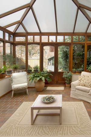 conservatory tables chairs plants room in house next to garden Stock Photo - 2044981