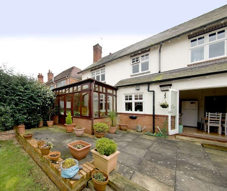 detached house with conservatory and garden