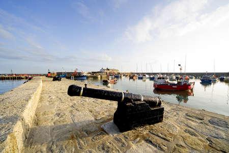 lyme: lyme regis dorset england uk cannon harbour wall Stock Photo