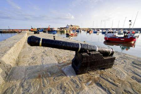 lyme regis dorset england uk cannon harbour wall Stock Photo - 2241064