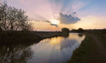 prior: Sunset on the worcester and birmingham canal at stoke prior Worcestershire.