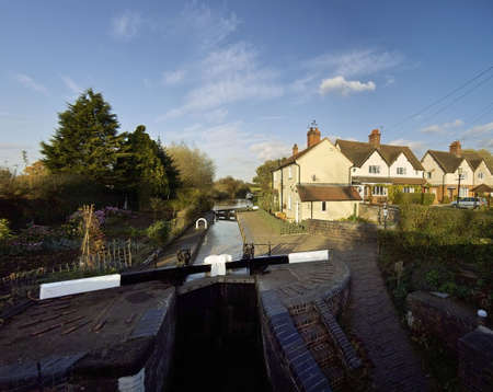 worcester and birmingham canal: Lock gate and cottage on the worcester and birmingham canal stoke prior worcestershire. Stock Photo