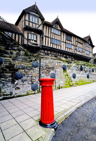 A victorian postbox and the Lord leycester hospital in the centre of warwick. photo