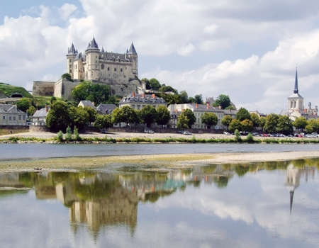 loire: The chateau at saumur on the banks of the river loire.