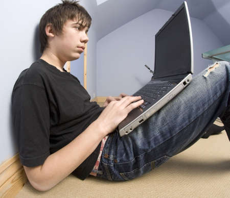 13 year old: 13 year old  boy teenager with laptop computer  Stock Photo