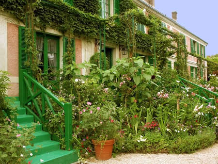 A house with a garden full of flowers. Stock Photo