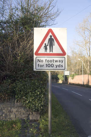 footway: A road sign indicating no footway for 100 yards