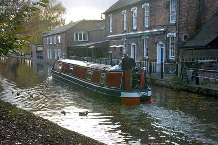 worcester and birmingham canal: A narrow boat or barge on the worcester and birmingham canal stoke prior worcestershire.