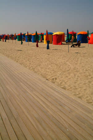 boardwalk: The planche and beach at Deauville, Seine-maritime, Normandy, France.