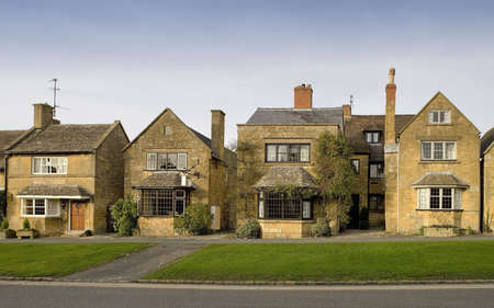 Town houses on the  high street broadway cotswolds worcestershire uk. photo
