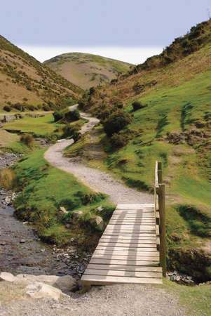 mill valley: A stream and a footpath uphill in the carding mill valley shropshire england uk Stock Photo