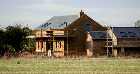 A house undergoing building work. Stock Photo