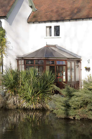 A conservatory  room in house next to garden. Stock Photo