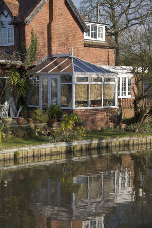 A conservatory  room in house next to garden Stock Photo