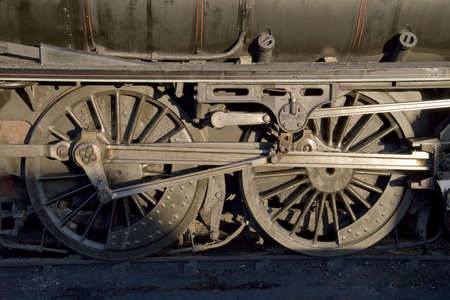 horse pipes: Close up of the boiler and wheels on an old steam locomotive.