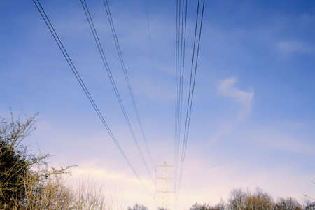 electricity supply: A metal pylon carrying electricity supply power lines.