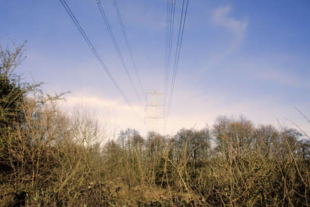 A metal pylon carrying electricity supply power lines. photo