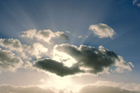 shafts: A cloudscape in the sky with clouds and shafts of light. Stock Photo