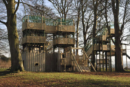 An adventure playground made from wood with walkways. photo