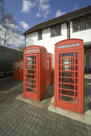 Four red telephone boxes in an english village. photo