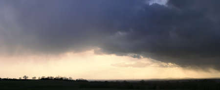 A storm over the malvern  hills photo