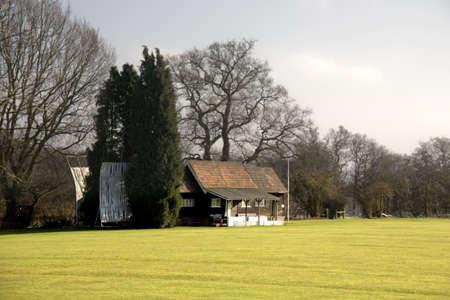 A cricket pitch and pavillion Stock Photo