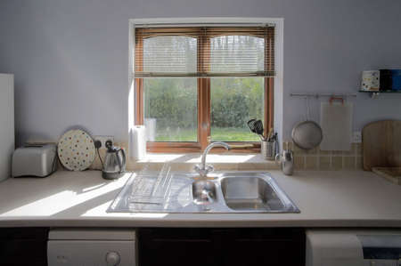 show window: colour image od a  kitchen in newly restored rebuilt house with work surfaces