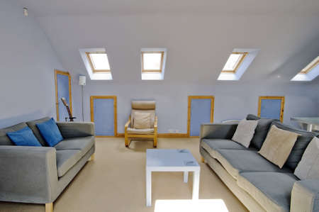 converted: lounge area in newly restored rebuilt house  Stock Photo