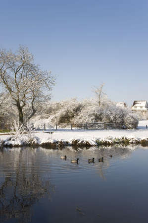 A snow covered rural landscape in the countryside photo