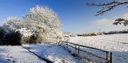 sub zero: A snow covered rural landscape in the countryside Stock Photo
