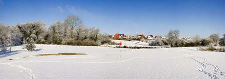 christmas golf: A snow covered rural landscape in the countryside Stock Photo