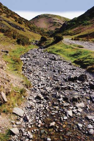mill valley: footpath stream footpath uphill carding mill valley shropshire england uk