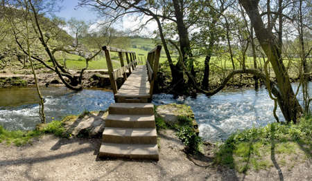 derbyshire: river dove dovedale peak district national park derbyshire staffordshire england uk Stock Photo