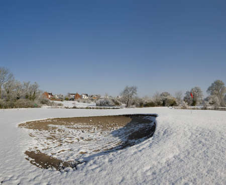 redditch: A snow covered hole on a golf course